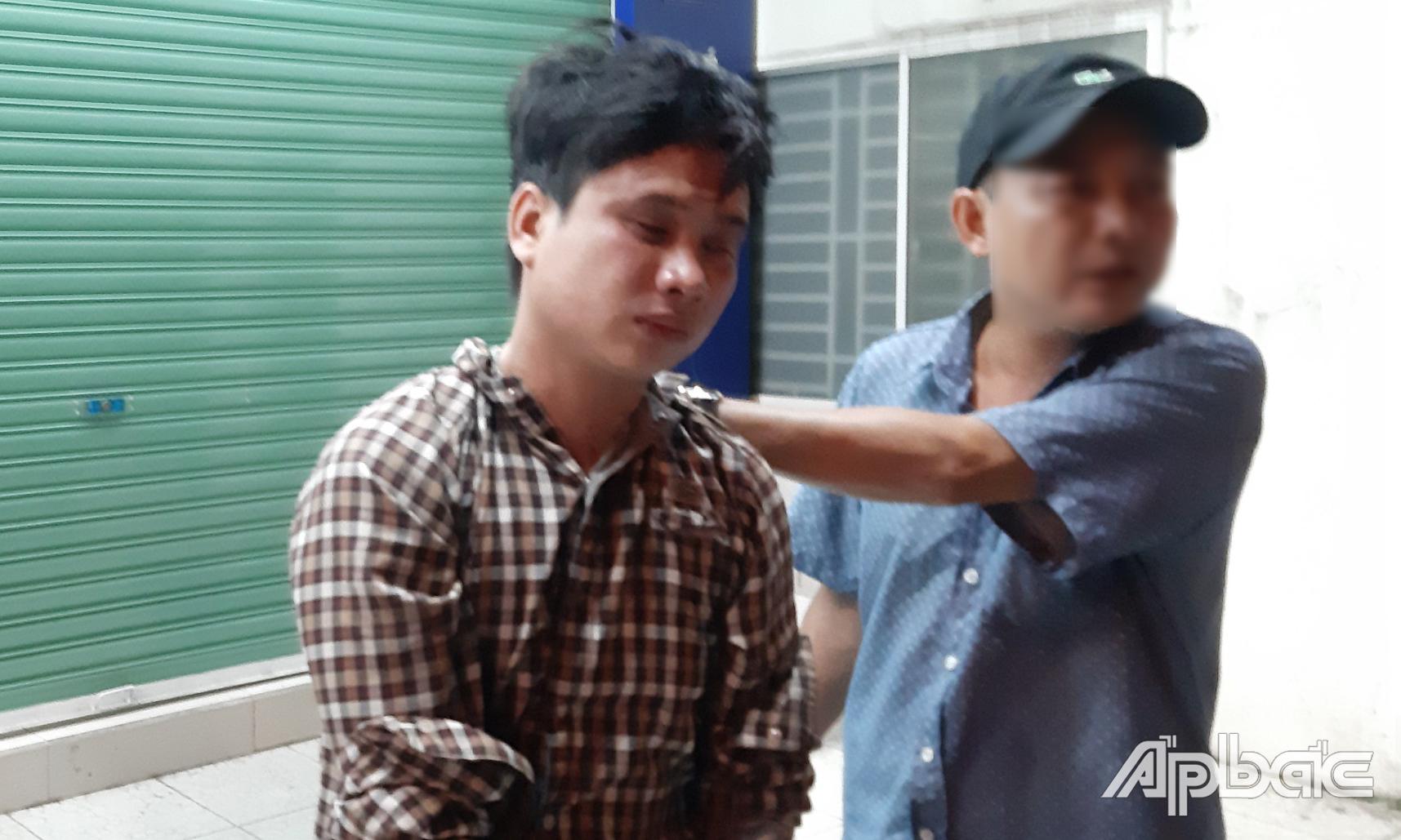 Việt lúc bị bắt giữ.